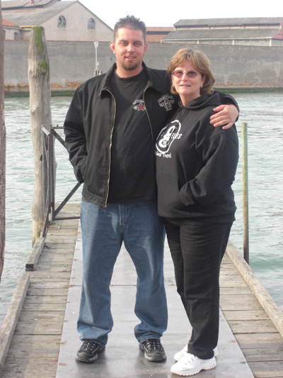 Chris and I are standing on a dock right outside our apartment on the island of Murano.