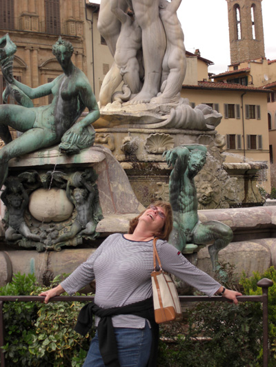 I'm usually taking the pictures.  Here's a rare pic of me goofing off in from of the fountain of Neptune.